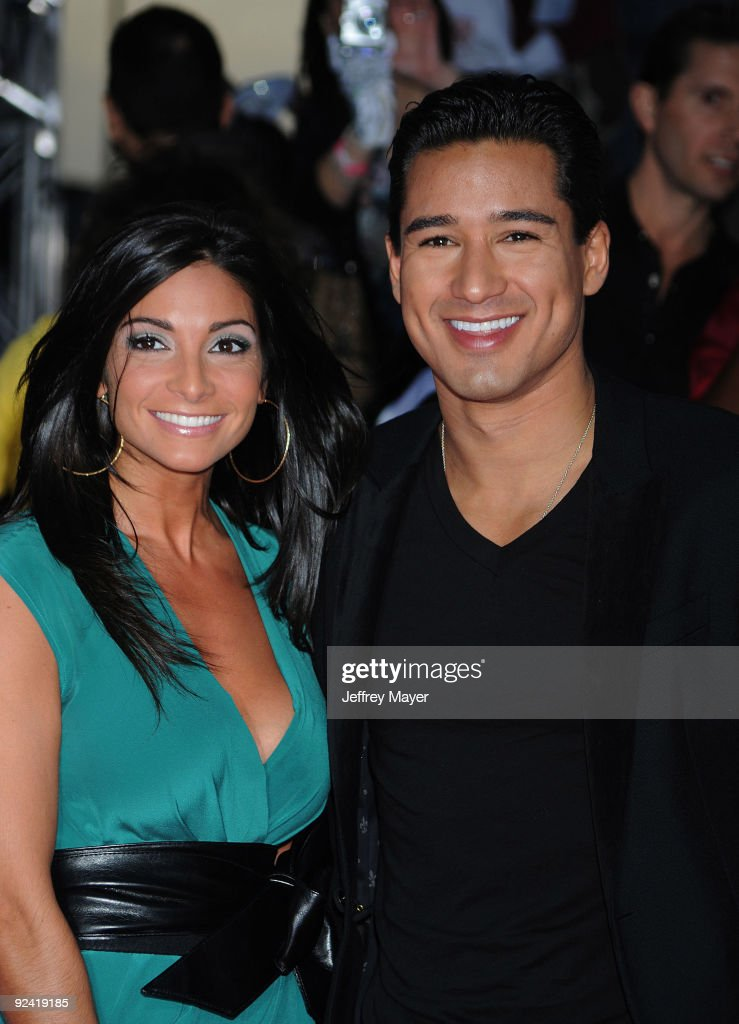 Courtney Mazza and actor Mario Lopez arrive at the Los Angeles Premiere of 'This Is It' held at Nokia Theatre L.A. Live on October 27, 2009 in Los Angeles, California.