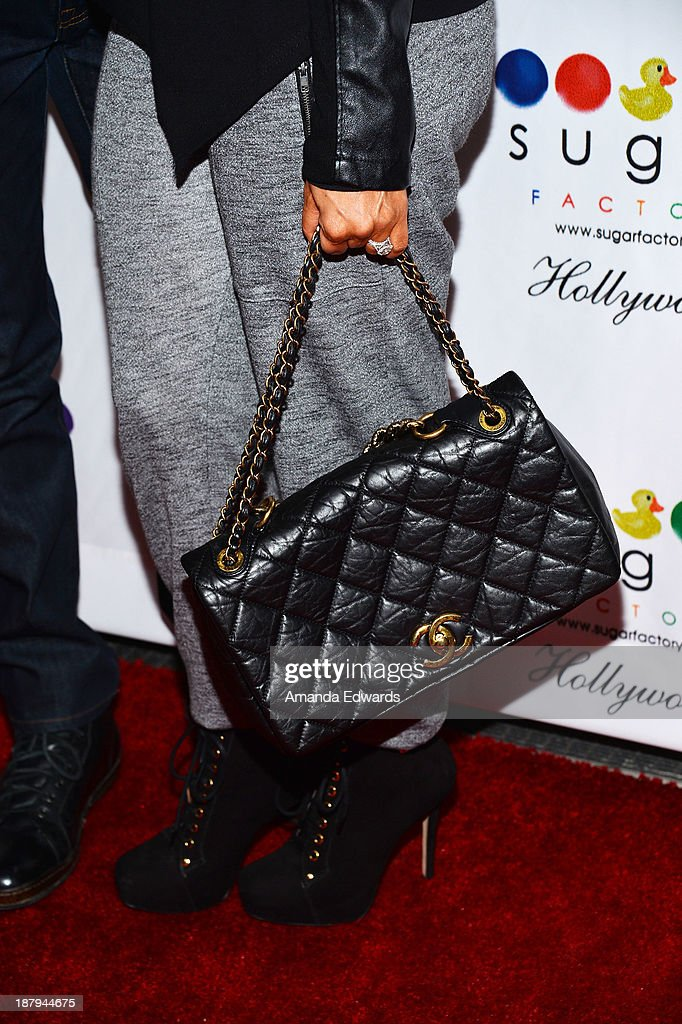 Courtney Mazza (handbag detail) arrives at the grand opening of Sugar Factory Hollywood at Sugar Factory on November 13, 2013 in Hollywood, California.