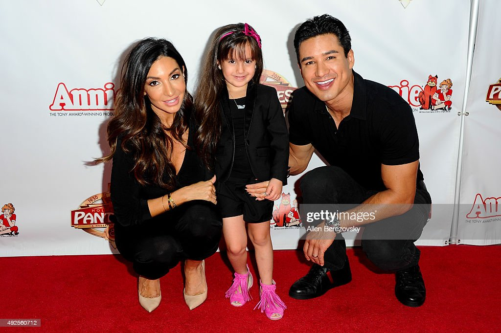 Courtney Mazza, Gia Lopez and actor Mario Lopez attend the premiere of 'Annie' at the Hollywood Pantages Theatre on October 13, 2015 in Hollywood, California.