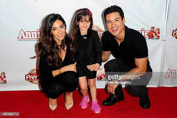 Courtney Mazza Gia Lopez and actor Mario Lopez attend the premiere of 'Annie' at the Hollywood Pantages Theatre on October 13 2015 in Hollywood...