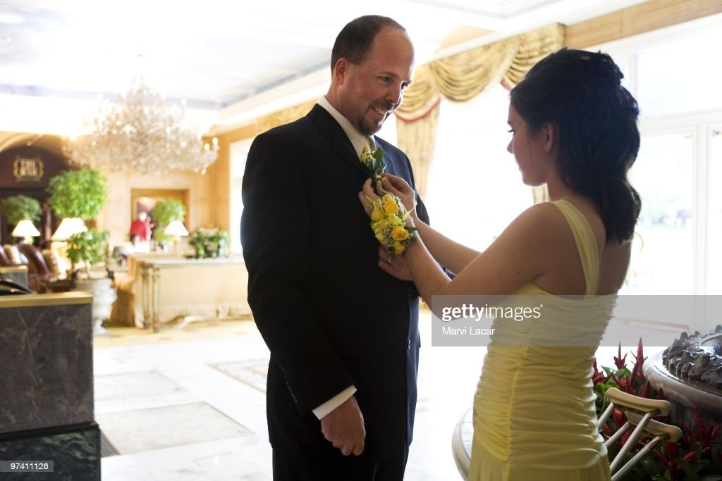 Courtney McAlpin pins a corsage on her father's lapel on May 16, 2008 in Colorado Springs, Colorado. The Father Daughter Purity Ball , founded in 1998 by Randy and Lisa Wilson, focuses on the idea that a trustworthy and nurturing father will influence his daughter to lead a lifestyle of 'integrity and purity.'