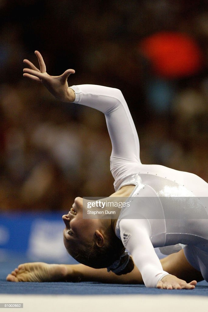 Courtney McCool poses at the end of her floor exercise during the Women's finals of the U.S. Gymnastics Olympic Team Trials on June 27, 2004 at The Arrowhead Pond of Anaheim in Anaheim, California.