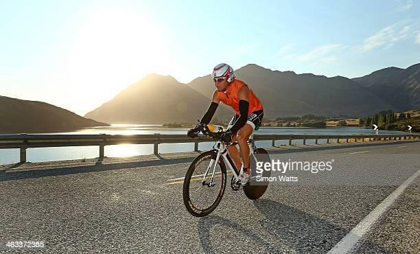 Courtney Ogden of Australia rides along the lake Wanaka waterfront during Challenge Wanaka on January 18 2014 in Wanaka New Zealand