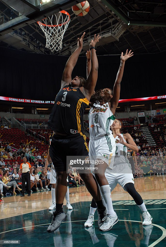 <a gi-track='captionPersonalityLinkClicked' href=/galleries/search?phrase=Courtney+Paris&family=editorial&specificpeople=4457244 ng-click='$event.stopPropagation()'>Courtney Paris</a> #3 of the Tulsa Shock attempts to rebound the ball against Angel Robinson #8 of the Seattle Storm during the game on August 10,2014 at Key Arena in Seattle, Washington.