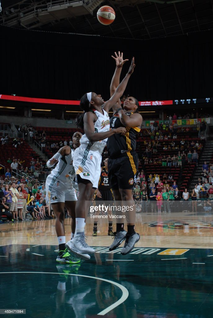 Courtney Paris #3 of the Tulsa Shock shoots against Crystal Langhorne #1 of the Seattle Storm during the game on August 10,2014 at Key Arena in Seattle, Washington.