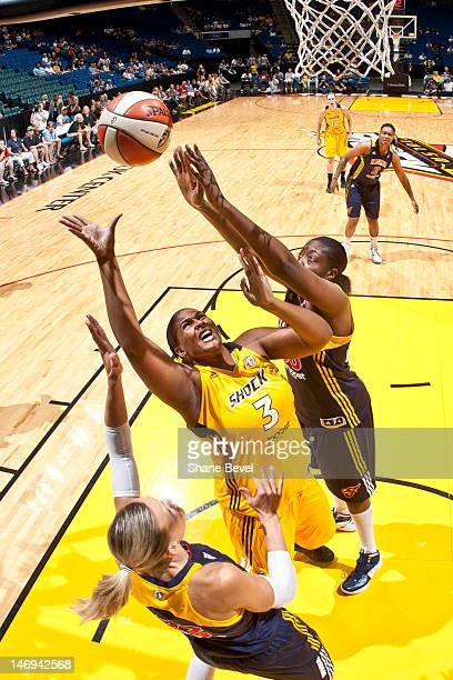 Courtney Paris of the Tulsa Shock shoots against Jessica Davenport and Katie Douglas of the Indiana Fever during the WNBA game on June 23 2012 at the...