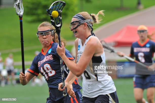 Courtney Patterson of Gettysburg College defends Leeann Bak of College of New Jersey during the Division III Women's Lacrosse Championship held at...