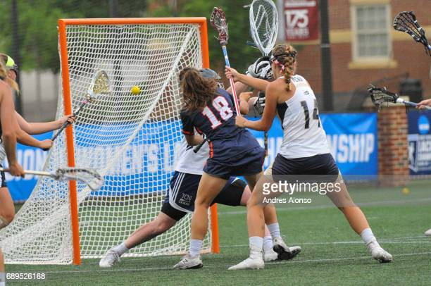 Courtney Patterson of Gettysburg College scores the tying goal late in the game defended by Elizabeth Morrison of College of New Jersey during the...