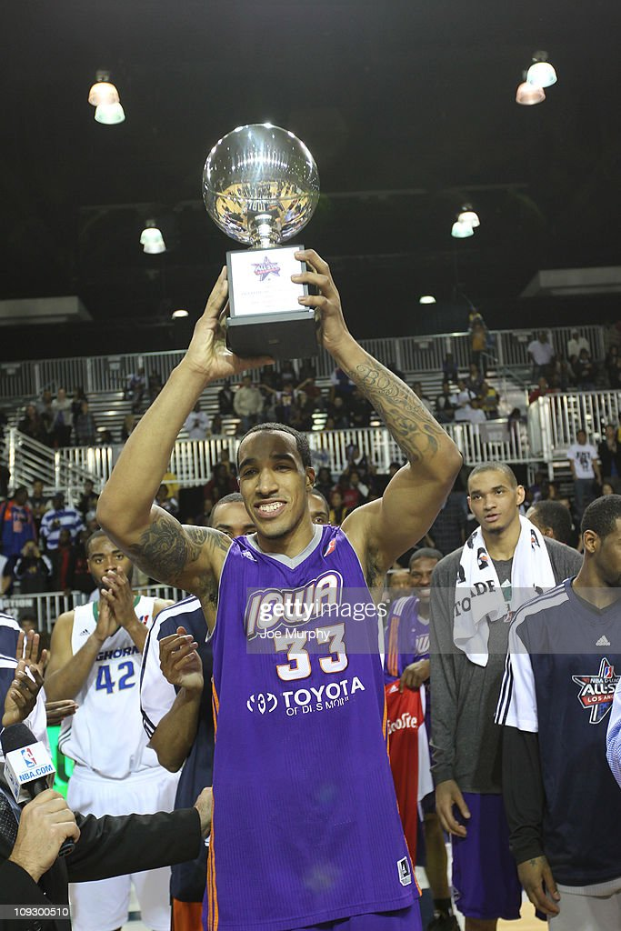 Courtney Sims #33 of the East All-Stars is presented with the MVP trophy after the 2011 NBA D-League All-Star Game presented by SonoSite on center court at Jam Session presented by Adidas during NBA All Star Weekend at the Los Angeles Convention Center on February 19, 2011 in Los Angeles, California.