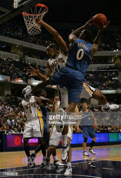 courtney-sims-of-the-indiana-pacers-collides-with-gilbert-arenas-of-picture-id77606619?s=594x594
