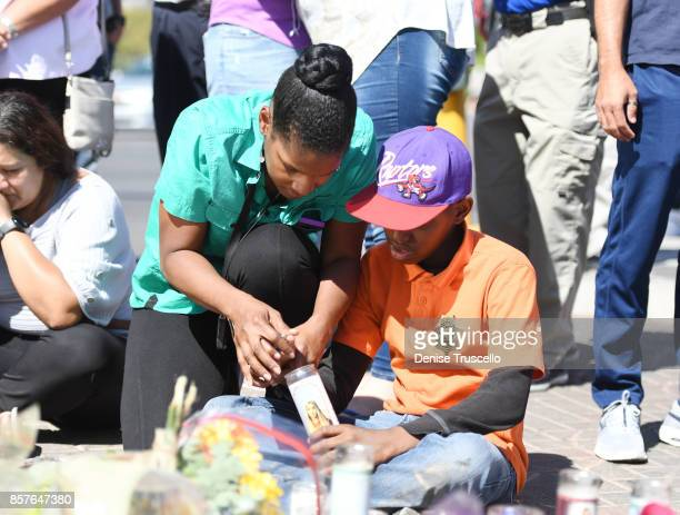 Courtney Smith and Ashton Smith of Las Vegas Nevada attend memorial on Las Vegas Boulevard and Reno Avenue for the victims of the Route 91 Harvest...