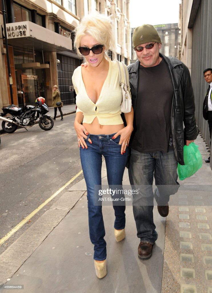 Courtney Stodden emerges with her husband Doug Hutchison after a wild night of partying at Whisky Mist nightclub. on September 20, 2013 in London, United Kingdom.