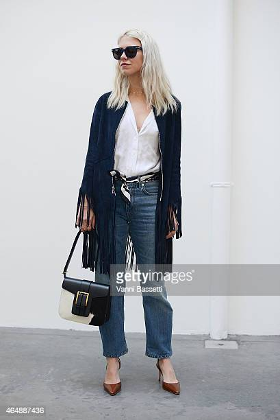 Courtney Trop poses wearing a Sandro jacket and Saint Laurent bag on March 1 2015 in Milan Italy