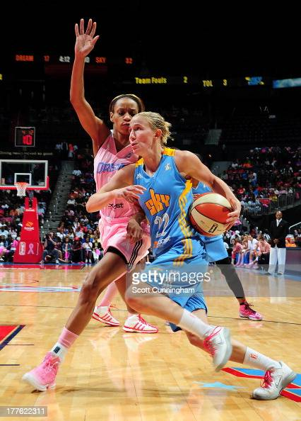 Courtney Vandersloot of the Chicago Sky drives against Jasmine Thomas of the Atlanta Dream at Philips Arena on August 24 2013 in Atlanta Georgia NOTE...