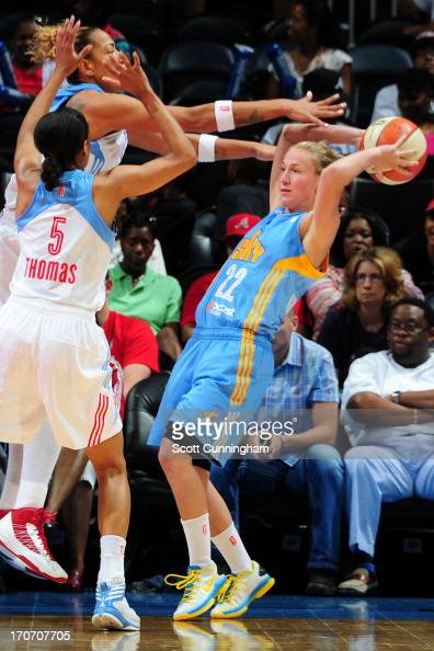 Courtney Vandersloot of the Chicago Sky is pressured by Jasmine Thomas and Erika deSouza of the Atlanta Dream at Philips Arena on June 16 2013 in...