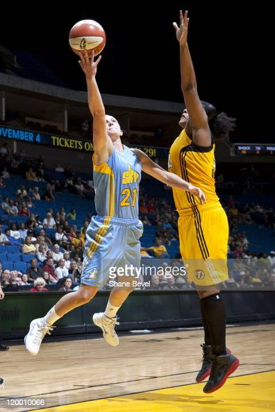 Courtney Vandersloot of the Chicago Sky makes a layup despite the efforts of Abi Olajuwon of the Tulsa Shock during the WNBA game on July 28 2011 at...