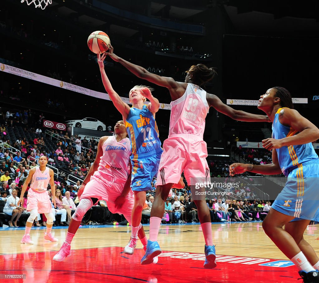 Courtney Vandersloot #22 of the Chicago Sky puts up a shot against Aneika Henry #13 of the Atlanta Dream at Philips Arena on August 24 2013 in Atlanta, Georgia.