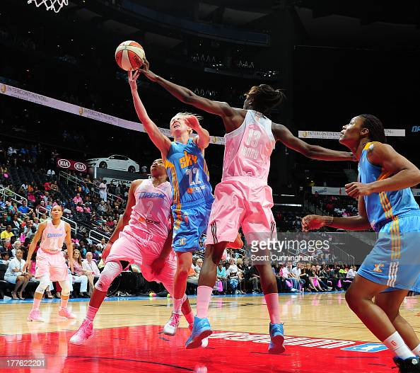 Courtney Vandersloot of the Chicago Sky puts up a shot against Aneika Henry of the Atlanta Dream at Philips Arena on August 24 2013 in Atlanta...