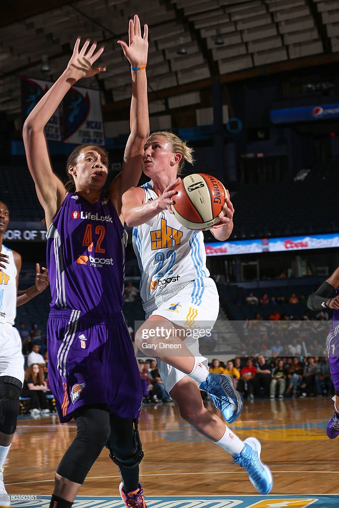 Courtney Vandersloot #22 of the Chicago Sky shoots against Brittney Griner #42 of the Phoenix Mercury during the game on September 11, 2013 at the Allstate Arena in Rosemont, Illinois.