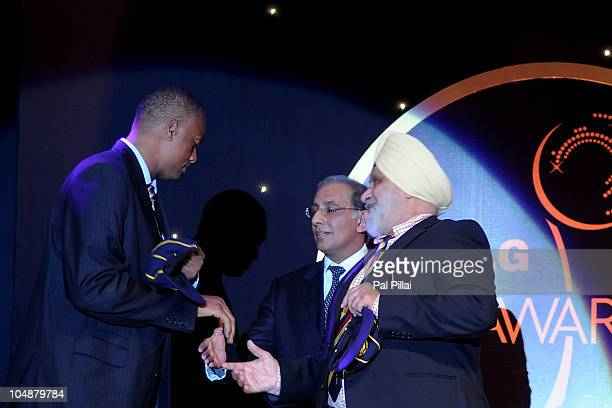 Courtney Walsh receives the Hall of Fame award from Bishan Singh Bedi during the ICC Annual Awards at the Grand Castle on October 6 2010 in Bangalore...