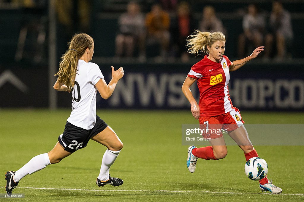 Courtney Wetzel #20 of Portland Thorns FC defends against McCall Zerboni #7 of Western New York Flash in the National Women's Soccer League Championship at Sahlen's Stadium August 31, 2013 in Rochester, New York.