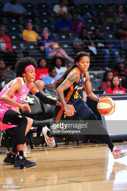 Courtney Williams of the Connecticut Sun handles the ball against Brittney Sykes of the Atlanta Dream during at WNBA game on August 15 2017 at Hank...