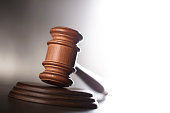 gavel, scales of justice, gray stone background