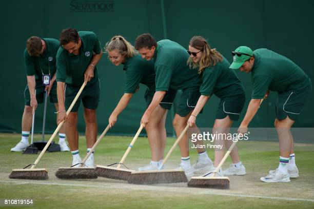 Courts are swept on day six of the Wimbledon Lawn Tennis Championships at the All England Lawn Tennis and Croquet Club on July 8 2017 in London...