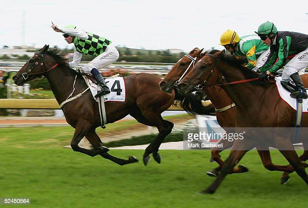 Courts In Session ridden by Hugh Bowman wins the Cathay Pacific George Ryder Stakes during the Golden Slipper Race Day at Rosehill Gardens Racecourse...