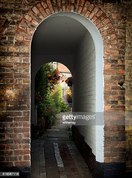 Courtyard garden through an arch