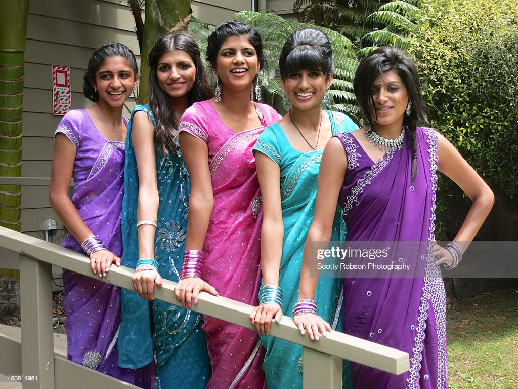 Cousin sisters posing in their finery at wedding