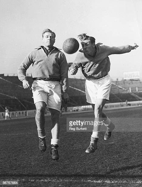 Cousins Jack left and Redfern Froggatt who play for Portsmouth and Sheffield Wednesday FC heading the ball during training at the Chelsea ground...