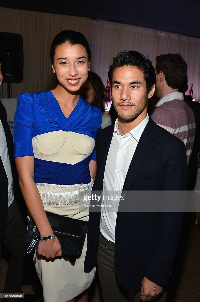 Cousins Lily Kwong and <a gi-track='captionPersonalityLinkClicked' href=/galleries/search?phrase=Joseph+Altuzarra+-+Fashion+Designer&family=editorial&specificpeople=5710924 ng-click='$event.stopPropagation()'>Joseph Altuzarra</a> attend the amfAR Inspiration Miami Beach Party on December 6, 2012 in Miami Beach, United States.