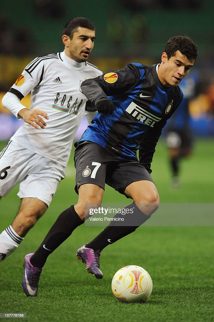 Coutinho (R) of FC Internazionale Milano in action against Rashad Sadygov of Neftci PFK during the UEFA Europa League group H match between FC Internazionale Milano and Neftci PFK on December 6, 2012 in Milan, Italy.