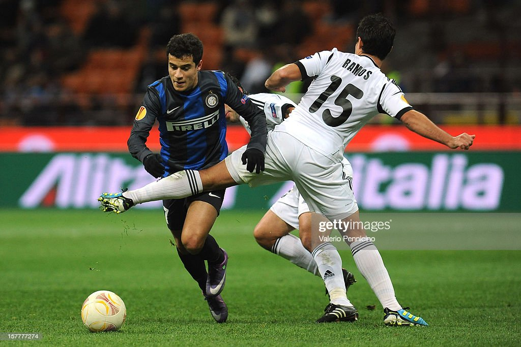 Coutinho (L) of FC Internazionale Milano is challenged by Eric Ramos of Neftci PFK during the UEFA Europa League group H match between FC Internazionale Milano and Neftci PFK on December 6, 2012 in Milan, Italy.