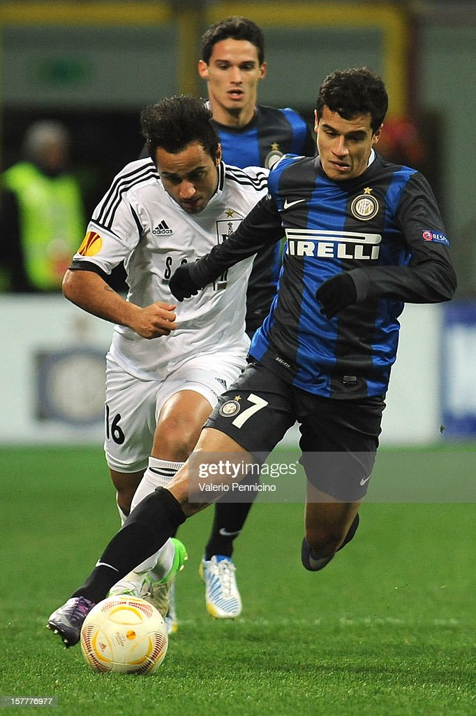 Coutinho (R) of FC Internazionale Milano runs of Bruno Bertucci of Neftci PFK during the UEFA Europa League group H match between FC Internazionale Milano and Neftci PFK on December 6, 2012 in Milan, Italy.