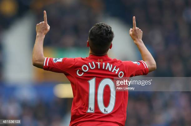 Coutinho of Liverpool celebrates scoring the opening goal during the Barclays Premier League match between Everton and Liverpool at Goodison Park on...