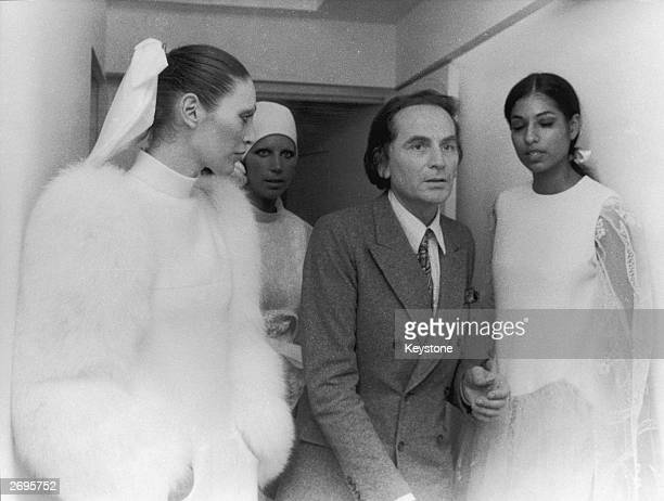 Couturier Pierre Cardin waits with models at his autumn/winter fashion show