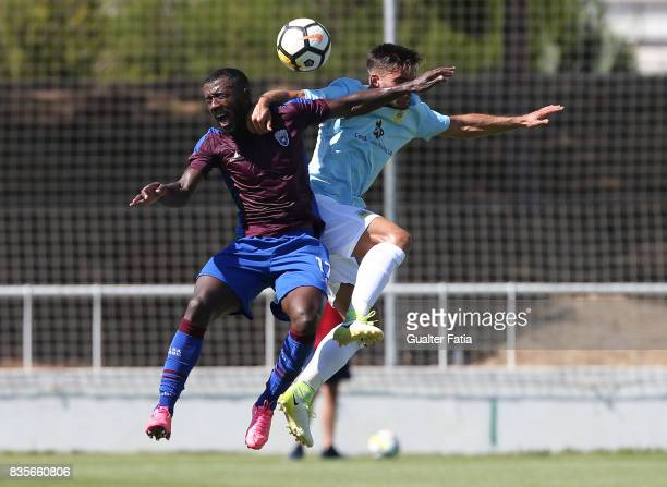 Cova da Piedade defender Adilson from Portugal with FC Arouca midfielder Nuno Valente from Portugal in action during the Segunda Liga match between...