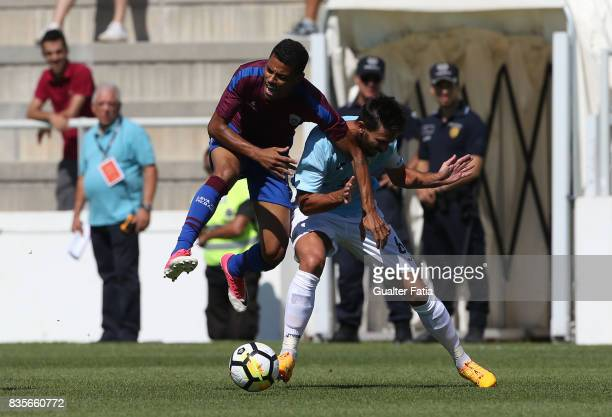 Cova da Piedade forward Dieguinho from Brazil tackled by FC Arouca defender Nuno Coelho from Portugal during the Segunda Liga match between CD Cova...