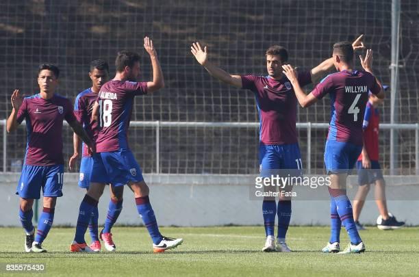 Cova da Piedade midfielder Thiago Freitas from Brazil celebrates with teammates after scoring a goal during the Segunda Liga match between CD Cova da...