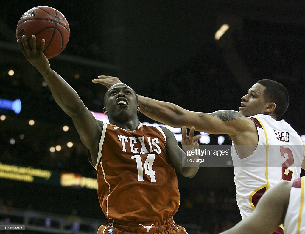 J'Covan Brown #14 of the Texas Longhorns shoots past Chris Babb #2 of the Iowa State Cyclones during the quarterfinals of the Big 12 Basketball Tournament March 8, 2012 at Sprint Center in Kansas City, Missouri. Texas won 71-65.
