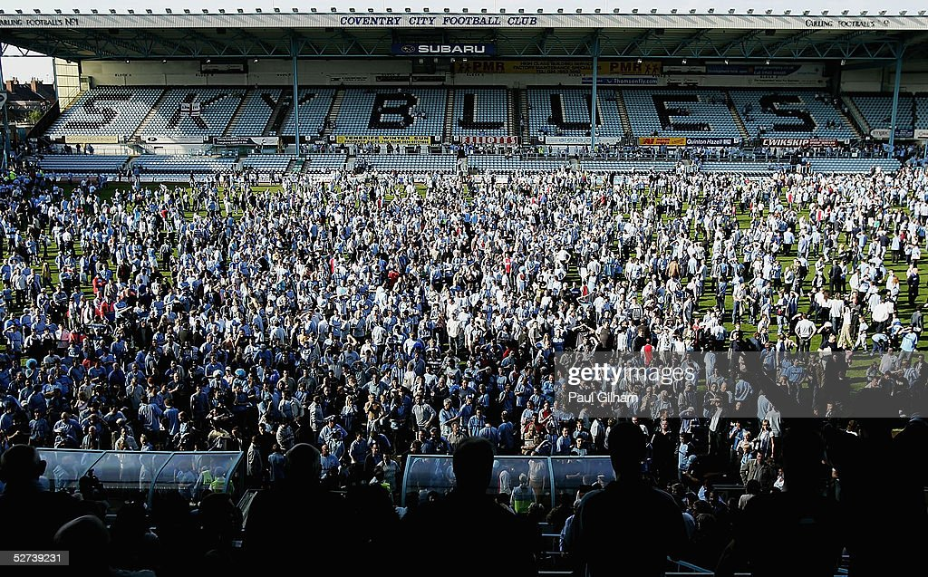 Coventry City fans invade the pitch at the end of the CocaCola Championship match between Coventry City and Derby County at Highfield Road on April...