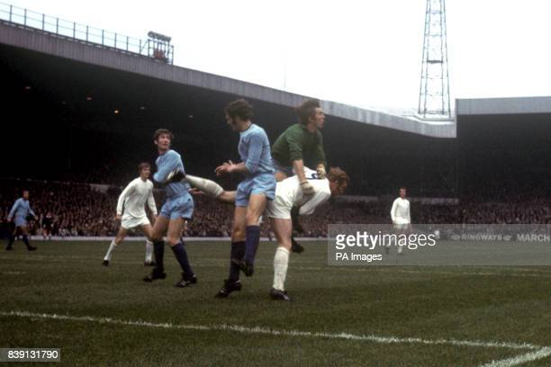 Coventry City goalkeeper Bill Glazier clears the ball ahead of Leeds United's Mick Jones