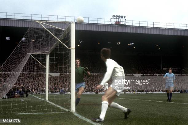 Coventry City goalkeeper Bill Glazier goes to catch the ball after it had hit the post with Leeds United's Allan Clarke following up
