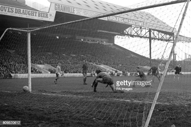 Coventry City goalkeeper Bill Glazier is beaten by a shot from Colin Bell for Manchester City's 4th goal of the game