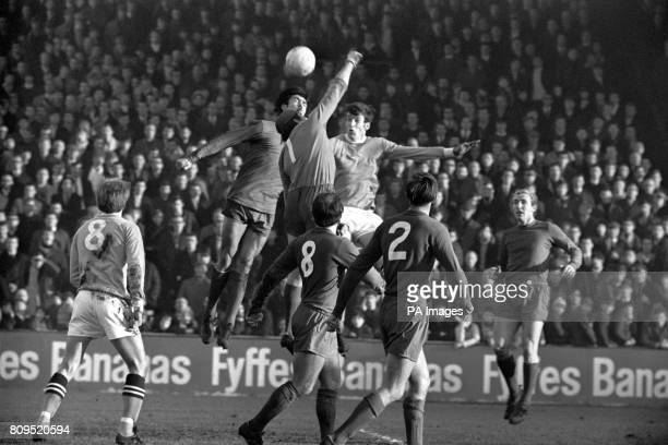 Coventry City goalkeeper Bill Glazier misses the ball under pressure from teammate Tony Hateley and Manchester City's Tommy Booth