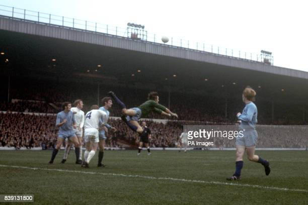 Coventry City goalkeeper Bill Glazier punches the ball clear