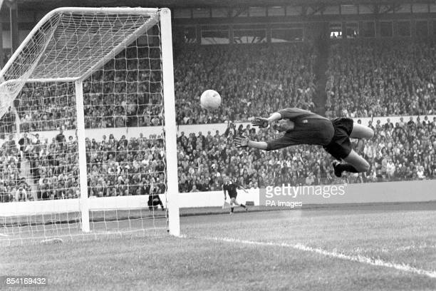 Coventry City goalkeeper Bill Glazier pushes a shot from Chelsea No11 Bill Garner round the post during the First Division match at Stamford Bridge...