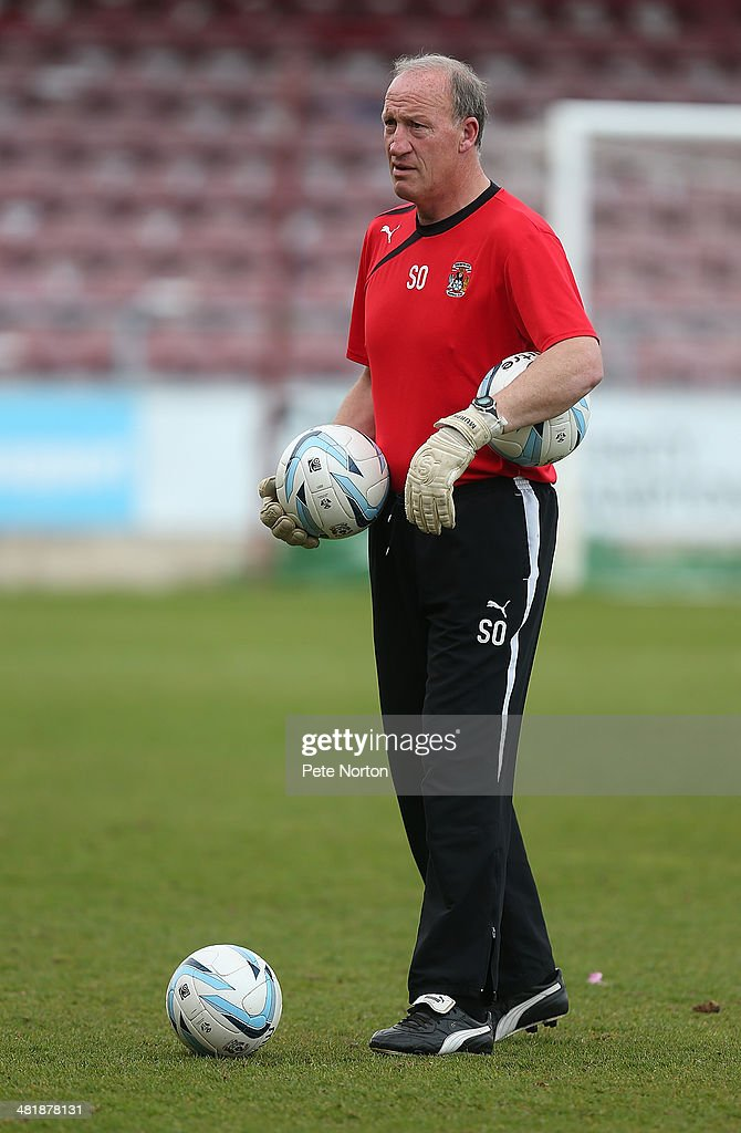 Coventry City goalkeeper coach Steve Ogrizovic looks on during the pre match warm up prior to the Sky Bet League One match between Coventry City and Bradford City at Sixfields Stadium on April 1, 2014 in Northampton, England.
